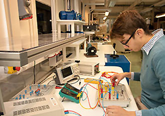 A male in an engineering lab