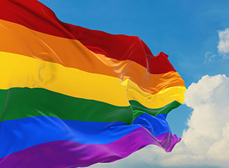 Flag with LGBTQ colours, the sky as a background
