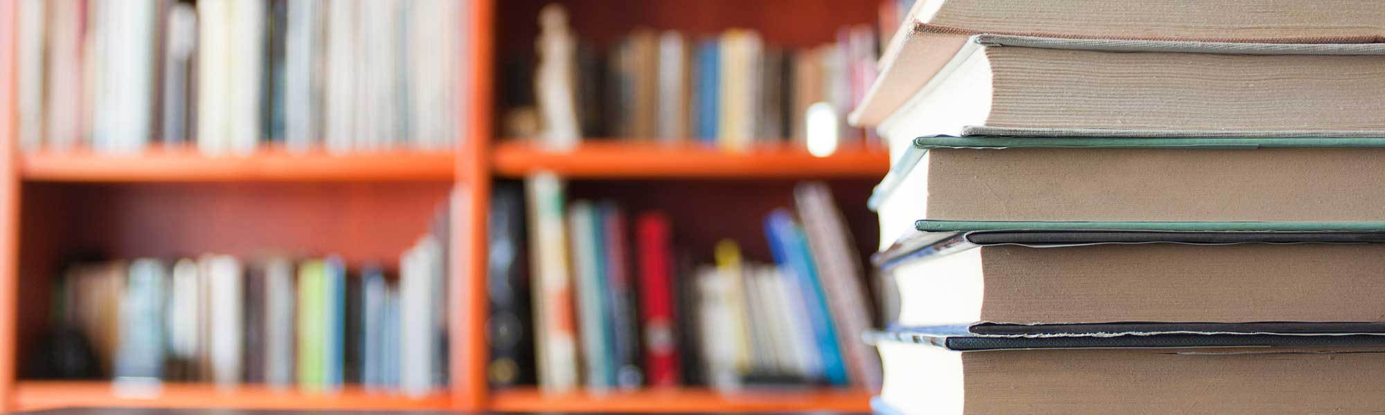 Books on table and on shelves