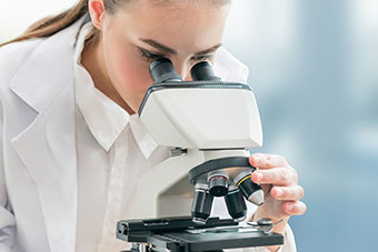 Girl at a microscope