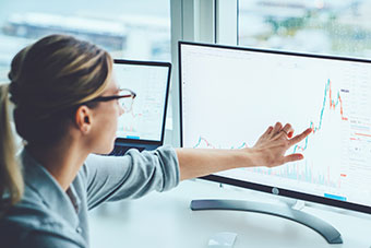 Woman pointing at screen