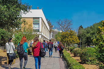 Msida campus with students walking along Vjal Tessie Camilleri