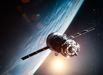 Spaceship in outer space near orbit of the Earth planet. Sun and stars on the background