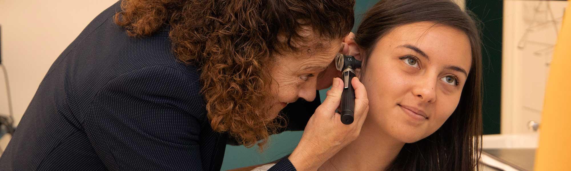 Prof. Helen Grech examining a patient