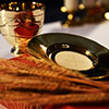Golden chalice, golden paten, Roman missal and wheat