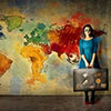 Girl with suitcase and the map of the word as a background image