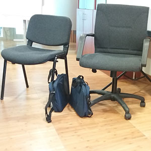 bags next to chairs