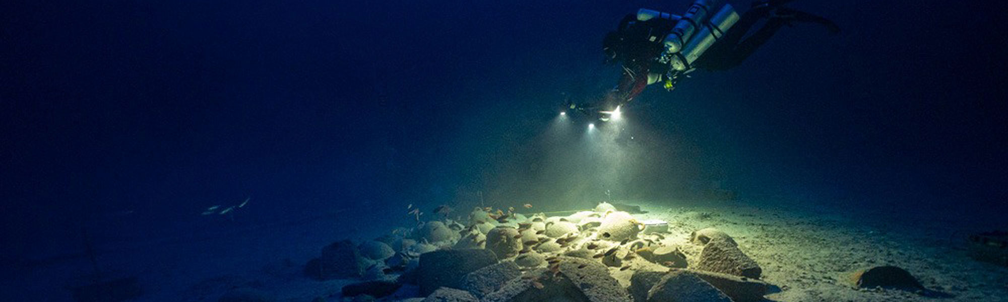 Diver exploring archaeological remains under-water