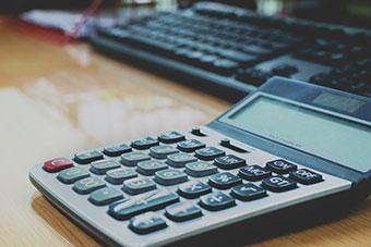 Calculator and keyboard on desk
