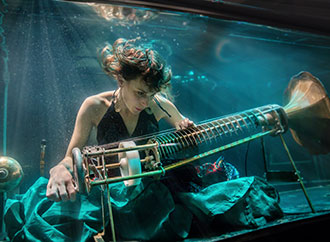 Playing an instrument underwater