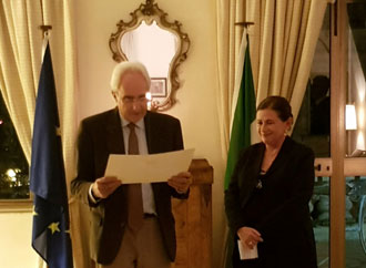 Professor Gloria Lauri-Lucente being given the Order of the star by the Italia Ambassador