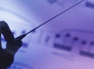 Hand, baton and music score