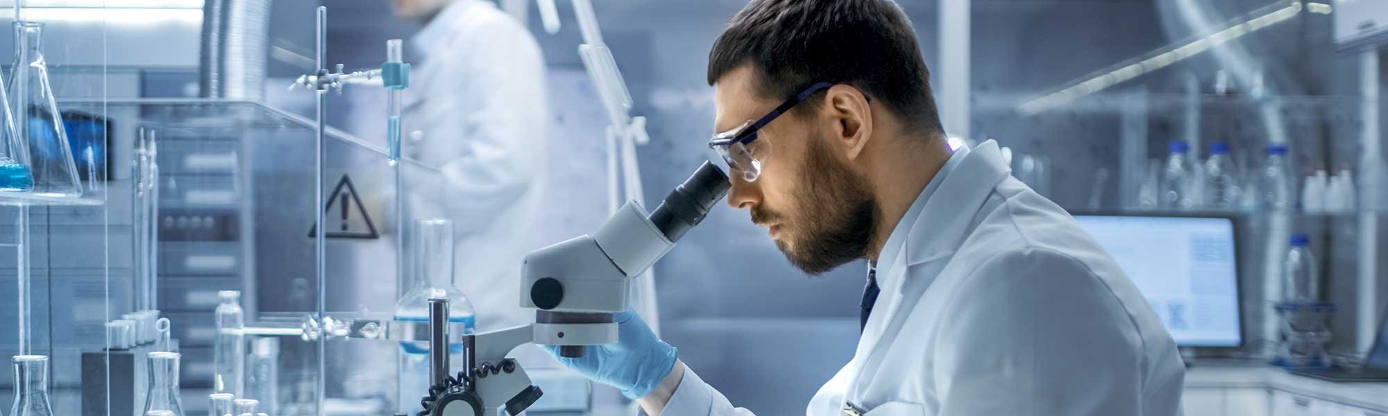 In a Modern Laboaratory Research Scientist Examines substance under microscope