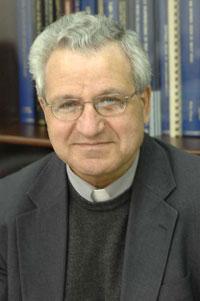 Rev. Prof. E. Agius